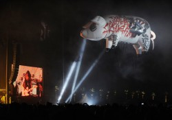 "A giant inflatable pig scrawled with the words ""Don't Be Led To the Slaughter"" floats over the crowd during Roger Waters' headlining set on the third day of the Coachella Valley Music and Arts Festival in Indio, Calif., Sunday, April 27, 2008. (AP Photo/Chris Pizzello)"